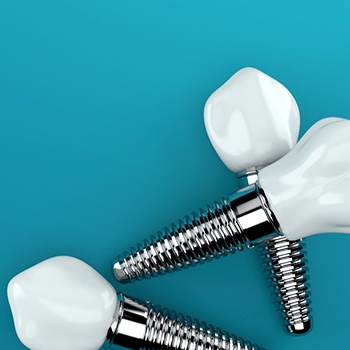 Three dental implants on blue background